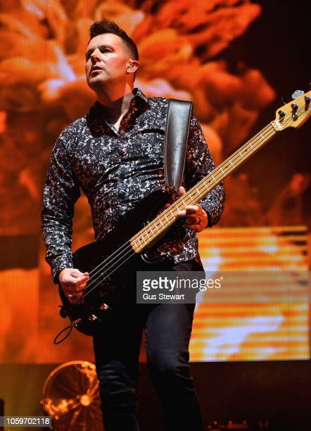 Tom Chapman of New Order performs on stage at Alexandra Palace on November 9 2018 in London England