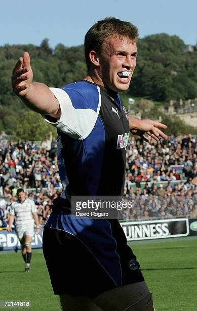 Tom Cheeseman of Bath celebrates after scoring a try during the EDF Energy Cup match between Bath and the Ospreys at the Recreation Ground on...