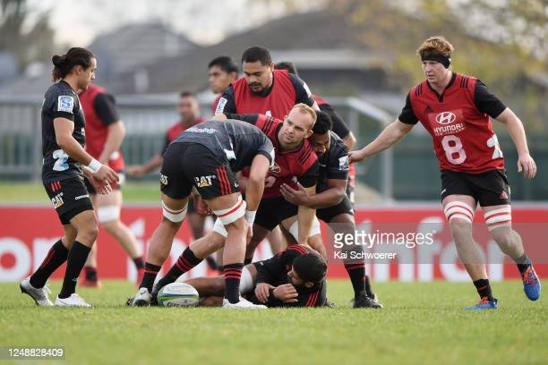 Tom Christie is tackled by George Bower during a Crusaders Super Rugby training session at Rugby Park on June 11, 2020 in Christchurch, New Zealand.