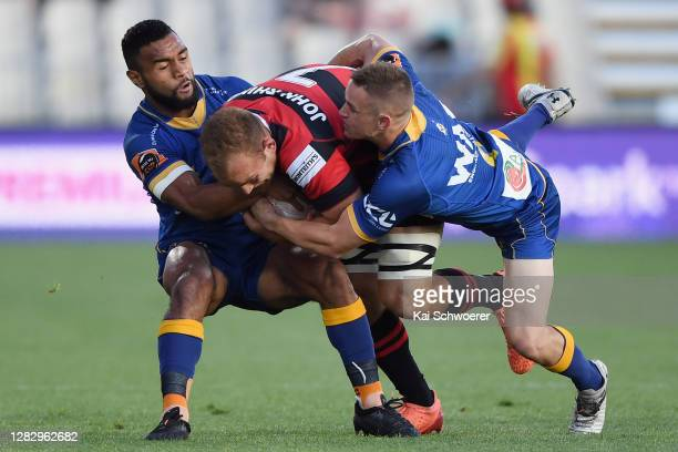 Tom Christie of Canterbury is tackled by Jona Nareki of Otago and Kayne Hammington of Otago during the round 8 Mitre 10 Cup match between Canterbury...
