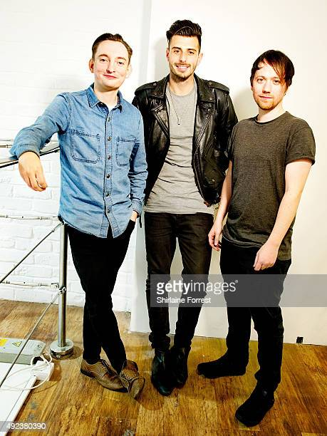 Tom Clarke, Liam Watts and Andy Hopkins of The Enemy pose backstage after performing and signing copies of their new album 'It's Automatic' at HMV on...