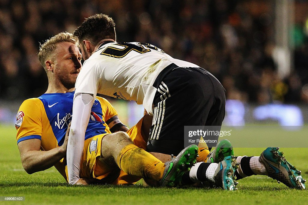 Tom Clarke (L) of Preston North End and James Husband of Fulham tussle on the ground during the Sky Bet Championship match between Fulham and Preston North End at Craven Cottage on November 28, 2015 in London, England.