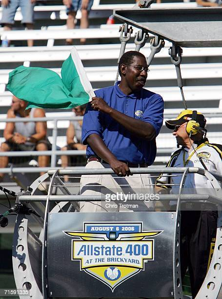 Tom Clarkson Field Vice President North Central Region Allstate Insurance Company waves the green flag to start qualifying for the Allstate 400 at...