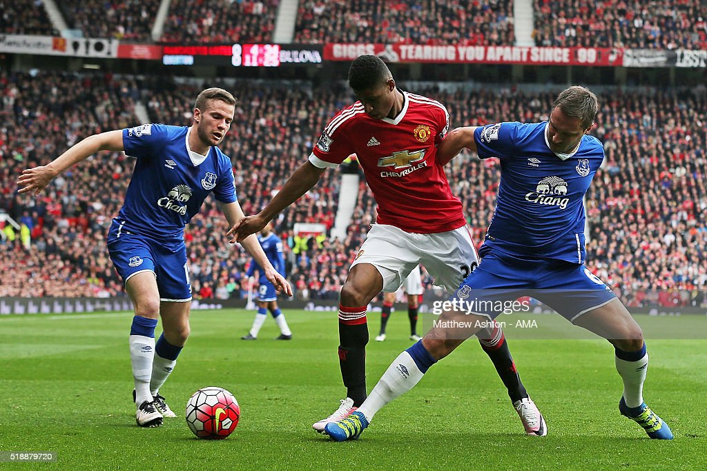 Tom Cleverley and Phil Jagielka (R) of Everton compete with Marcus Rashford of Manchester United during the Barclays Premier League match between Manchester United and Everton at Old Trafford on April 3, 2016 in Manchester, England.
