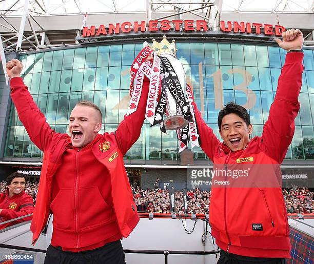 Tom Cleverley and Shinji Kagawa of Manchester United pose with the Premier League trophy at the start of the Premier League trophy winners parade on...