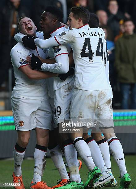 Tom Cleverley, Danny Welbeck amd Adnan Januzaj of Manchester United celebrate James Chester of Hull City scoring an own goal during the Barclays...