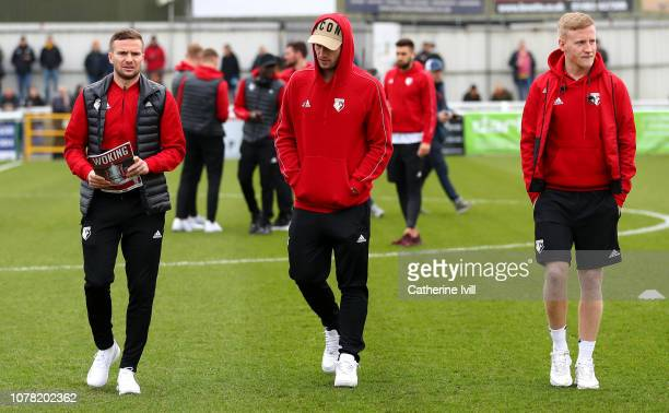 Tom Cleverley Daryl Janmaat and Will Hughes of Watford walk on the pitch prior to the FA Cup Third Round match between Woking and Watford at...
