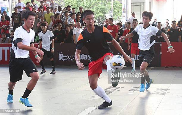 Tom Cleverley Jonny Evans and Rafael da Silva of Manchester United coach two local fiveaside teams in a Nike tournament as part of the FC 247...