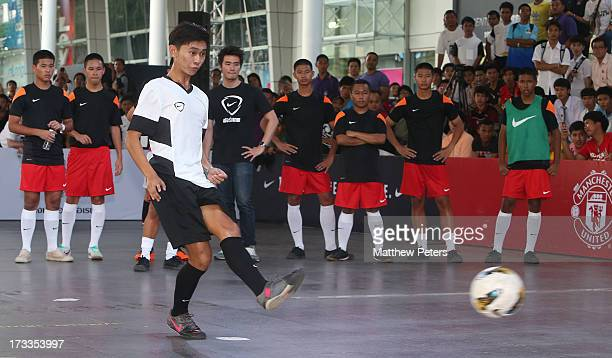 Tom Cleverley Jonny Evans and Rafael da Silva of Manchester United coach two local teams in a fiveaside competition as part of Nike FC247 campaign as...