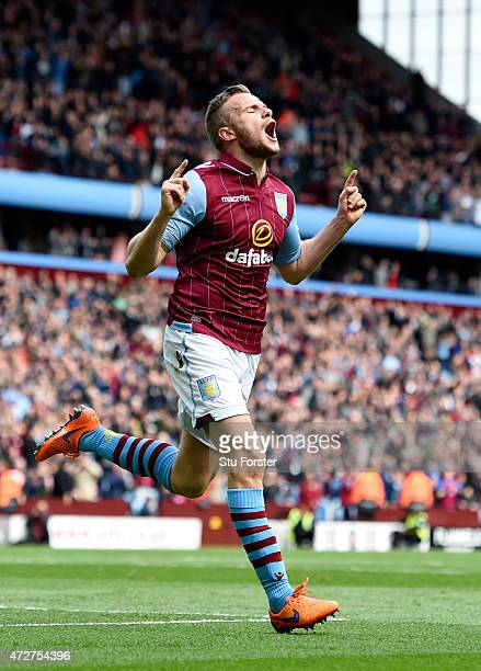 Tom Cleverley of Aston Villa celebrates scoring the opening goal during the Barclays Premier League match between Aston Villa and West Ham United at...