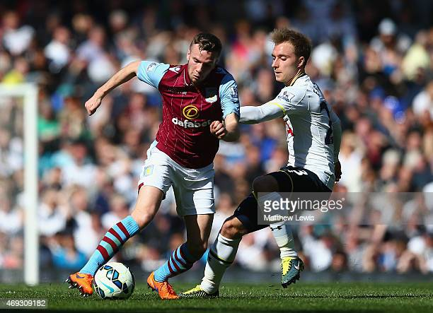 Tom Cleverley of Aston Villa is challenged by Christian Eriksen of Spurs during the Barclays Premier League match between Tottenham Hotspur and Aston...