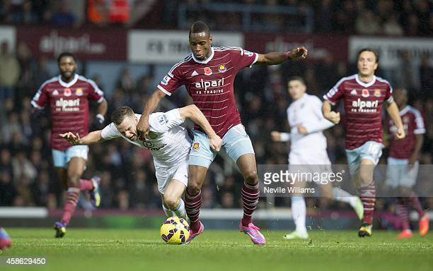 Tom Cleverley of Aston Villa is challenged by Diafra Sakho of West Ham United during the Barclays Premier League match between West Ham United and...