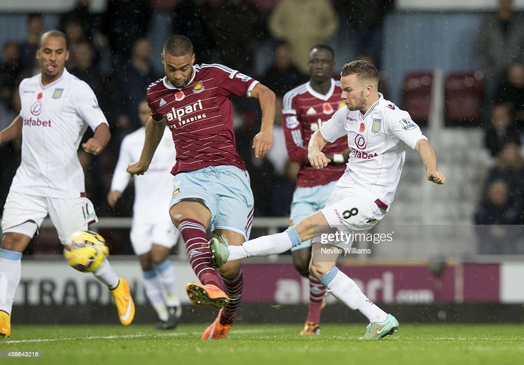 Tom Cleverley of Aston Villa is challenged by Winston Reid of West Ham United during the Barclays Premier League match between West Ham United and Aston Villa at the Boleyn Ground on November 08, 2014 in London, England.