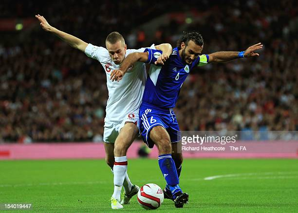 Tom Cleverley of England and Alessandro Della Valle of San Marino compete for the ball during the FIFA 2014 World Cup Group H qualifying match...