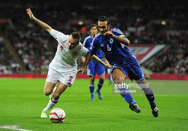 Tom Cleverley of England battles for the ball with Alessandro Della Valle of San Marino during the FIFA 2014 World Cup Group H qualifying match...
