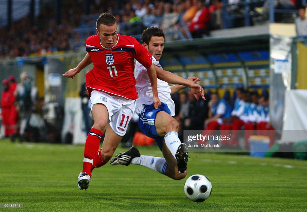 Tom Cleverley of England battles with Leonidas Argyropoulos of Greece during the UEFA U21 Championship match between Greece and England at the Asteras Tripolis Stadium on September 8, 2009 in Tripolis, Greece.