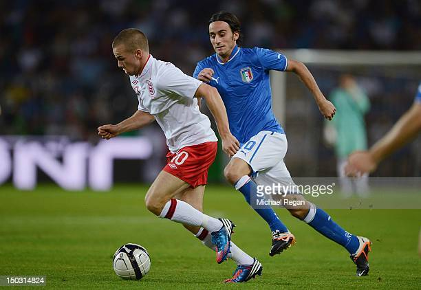 Tom Cleverley of England competes for the ball with Alberto Aquilani of Italy during the international friendly match between England and Italy at...