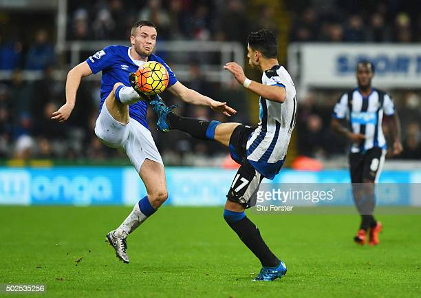 Tom Cleverley of Everton highkicking with Ayoze Perez of Newcastle United during the Barclays Premier League match between Newcastle United and...