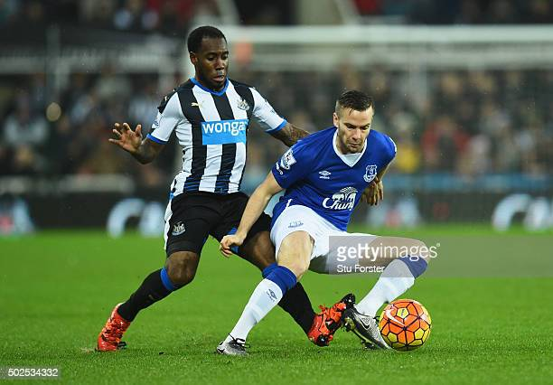 Tom Cleverley of Everton is watched by Vurnon Anita of Newcastle United during the Barclays Premier League match between Newcastle United and Everton...