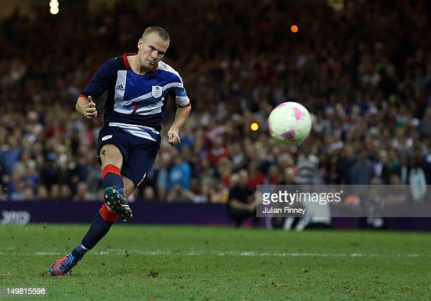 Tom Cleverley of Great Britain scores a penalty in the shoot out during the Men's Football Quarter Final match between Great Britain and Korea, on...