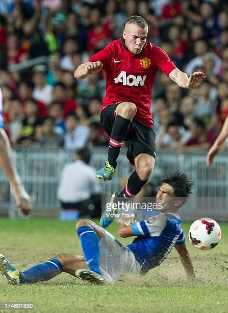 Tom Cleverley of Manchester United and Huang Yang of Kitchee FC fight for the ball during the international friendly match between Kitchee FC and...