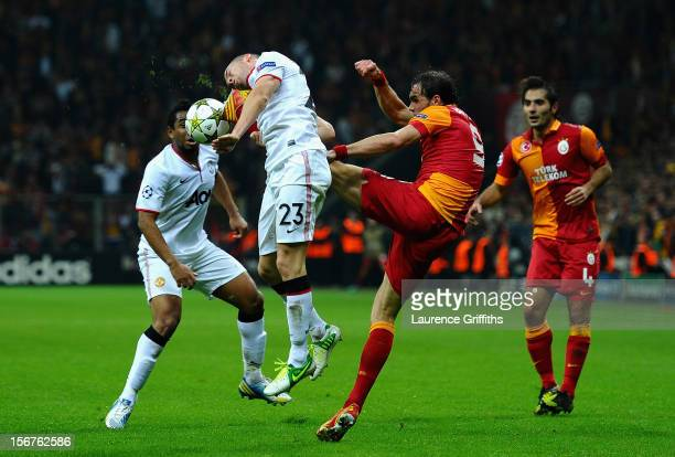 Tom Cleverley of Manchester United battles with Johan Elmander of Galatasary during the UEFA Champions League Group H match between Galatasaray and...