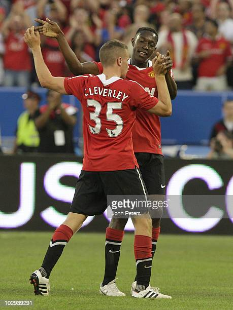Tom Cleverley of Manchester United celebrates scoring their third goal with Danny Welbeck during the preseason friendly match between Manchester...