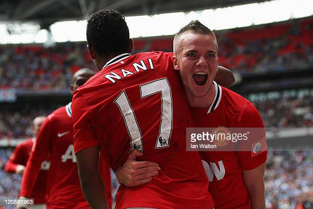 Tom Cleverley of Manchester United celebrates with goalscorer Nani after he scores the winning goal during the FA Community Shield match sponsored by...
