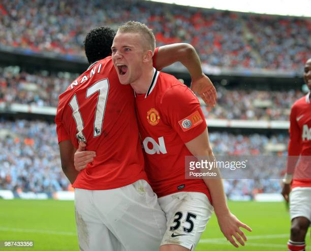Tom Cleverley of Manchester United celebrates with teammate and third goalscorer Nani during the FA Community Shield match between Manchester City...