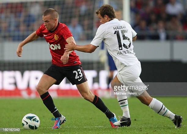 Tom Cleverley of Manchester United clashes with Henning Hauger of 96 Hannover during the pre-season friendly match between Hannover 96 and Manchester...