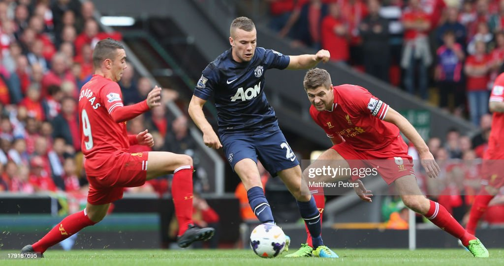 Tom Cleverley of Manchester United in action with Iago Aspas (L) and Steven Gerrard of Liverpool during the Barclays Premier League match between Liverpool and Manchester United at Anfield on September 01, 2013 in Liverpool, England.