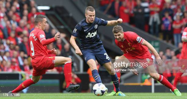 Tom Cleverley of Manchester United in action with Iago Aspas and Steven Gerrard of Liverpool during the Barclays Premier League match between...