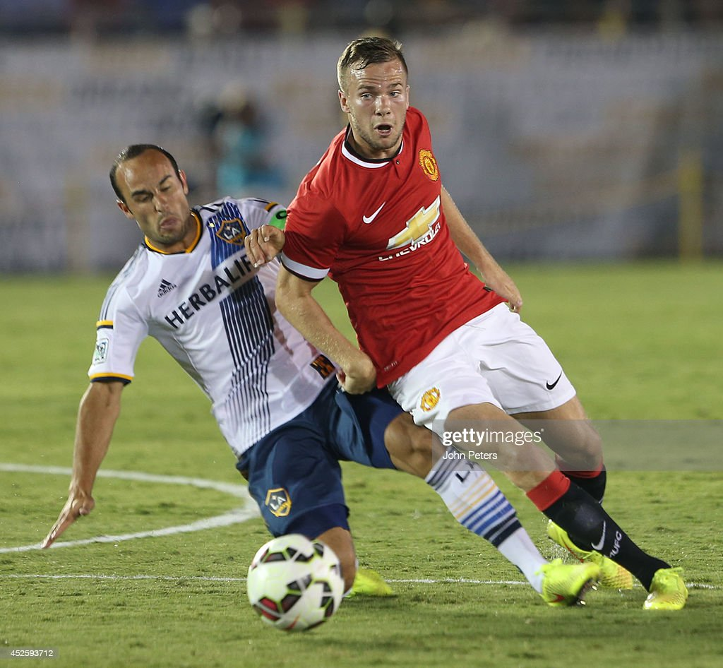 Tom Cleverley of Manchester United in action with Landon Donovan of Los Angeles Galaxy during the pre-season friendly match between LA Galaxy and Manchester United at Rose Bowl on July 23, 2014 in Pasadena, California.