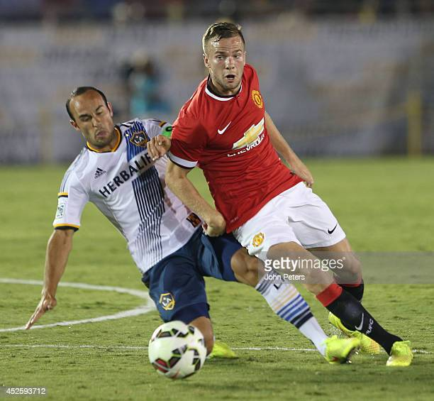 Tom Cleverley of Manchester United in action with Landon Donovan of Los Angeles Galaxy during the preseason friendly match between LA Galaxy and...