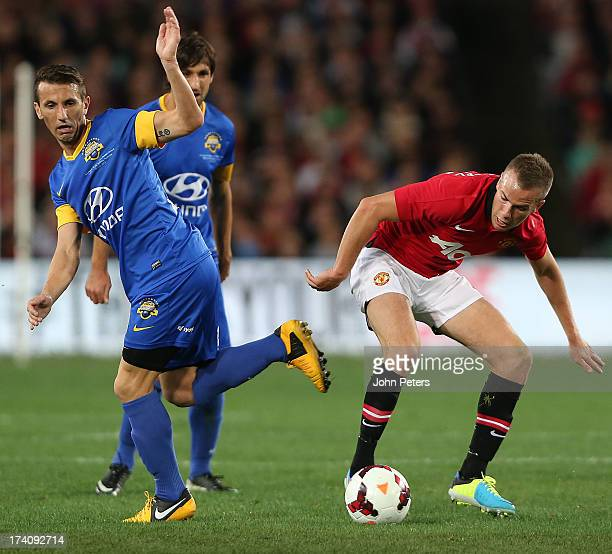 Tom Cleverley of Manchester United in action with Liam Miller of ALeague AllStars during the match between the ALeague AllStars and Manchester United...