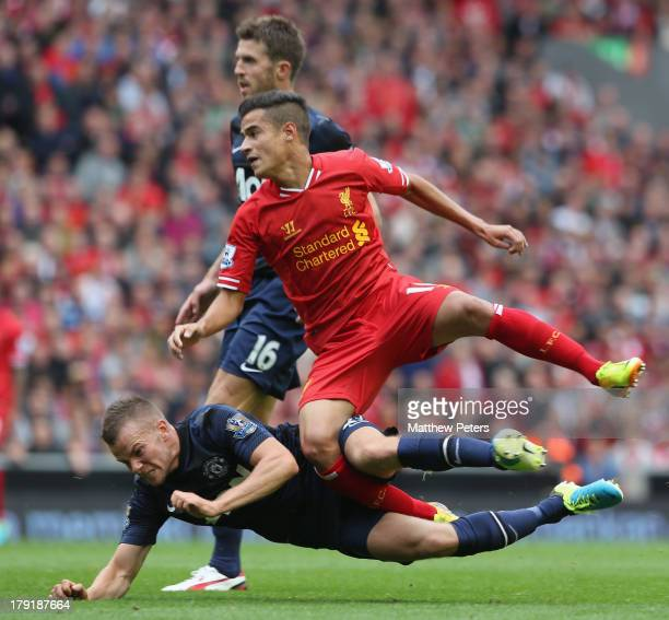 Tom Cleverley of Manchester United in action with Philippe Coutinho of Liverpool during the Barclays Premier League match between Liverpool and...