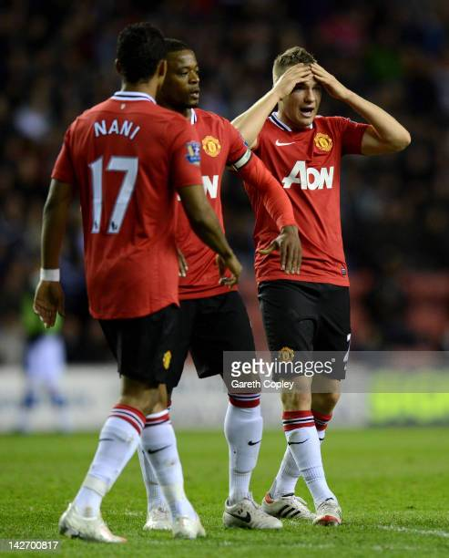 Tom Cleverley of Manchester United reacts during the Barclays Premier League match between Wigan Athletic and Manchester United at DW Stadium on...