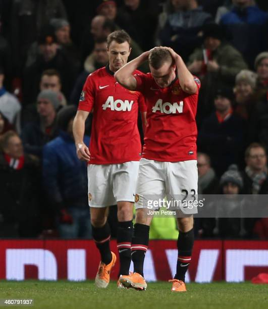 Tom Cleverley of Manchester United reacts to conceding a goal to Wilfried Bony of Swansea City during the FA Cup Third Round match between Manchester...