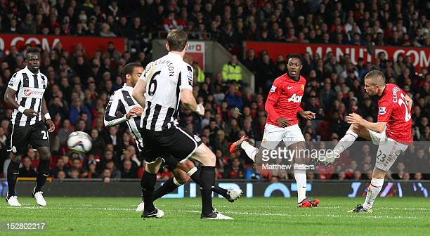 Tom Cleverley of Manchester United scores their second goal during the Capital One Cup Third Round match between Manchester United and Newcastle...