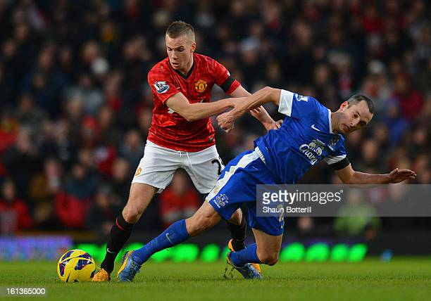 Tom Cleverley of Manchester United tangles with Leon Osman of Everton during the Barclays Premier League match between Manchester United and Everton...