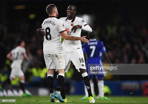 Tom Cleverley of Watford and Abdoulaye Doucoure of Watford celebrate a Watford goal during the Premier League match between Chelsea and Watford at...