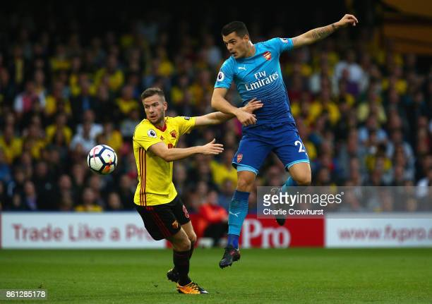 Tom Cleverley of Watford and Granit Xhaka of Arsenal in action during the Premier League match between Watford and Arsenal at Vicarage Road on...