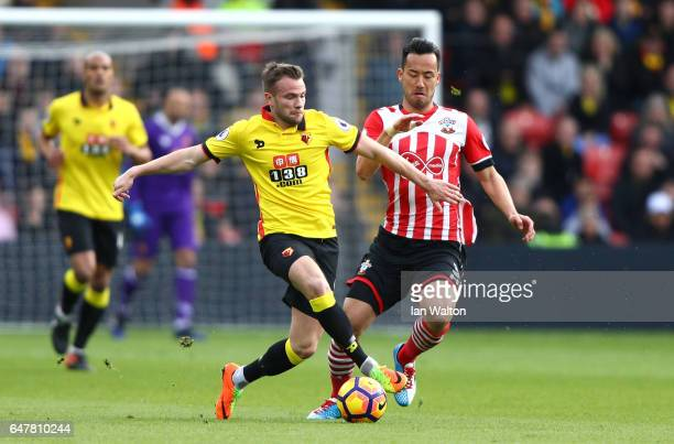 Tom Cleverley of Watford and Maya Yoshida of Southampton battle for possession during the Premier League match between Watford and Southampton at...