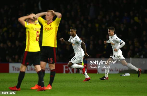 Tom Cleverley of Watford and teammate Ben Watson look dejected as Luciano Narsingh of Swansea City celebrates after scoring his sides second goal...