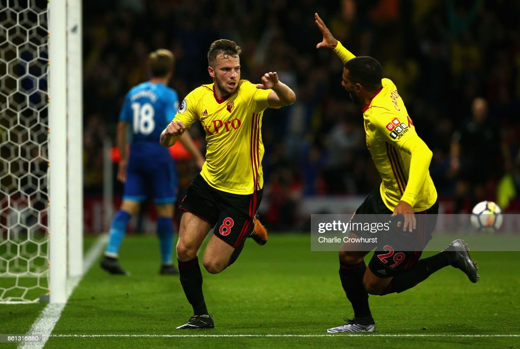 Tom Cleverley of Watford (8) celebrates as he scores their second goal with Etienne Capoue of Watford during the Premier League match between Watford and Arsenal at Vicarage Road on October 14, 2017 in Watford, England.