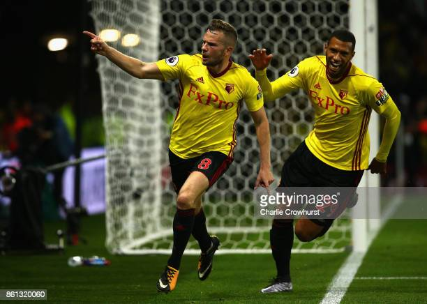 Tom Cleverley of Watford celebrates as he scores their second goal with Etienne Capoue of Watford during the Premier League match between Watford and...