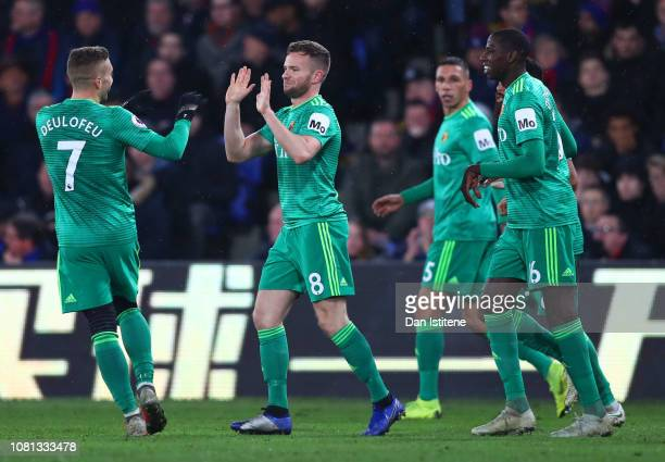 Tom Cleverley of Watford celebrates with teammates after scoring his team's second goal during the Premier League match between Crystal Palace and...