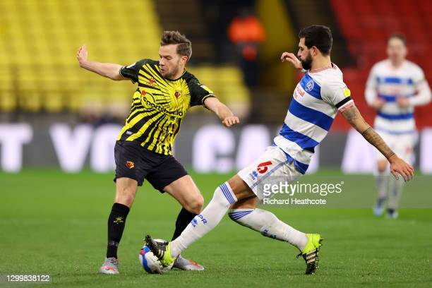 Tom Cleverley of Watford FC battles for possession with Yoann Barbet of Queens Park Rangers during the Sky Bet Championship match between Watford and...