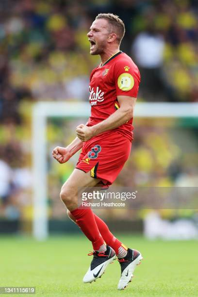 Tom Cleverley of Watford FC celebrates their team's third goal during the Premier League match between Norwich City and Watford at Carrow Road on...