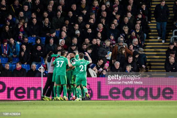 Tom Cleverley of Watford FC celebrates with team mates after scoring he's team 2nd goal during the Premier League match between Crystal Palace and...